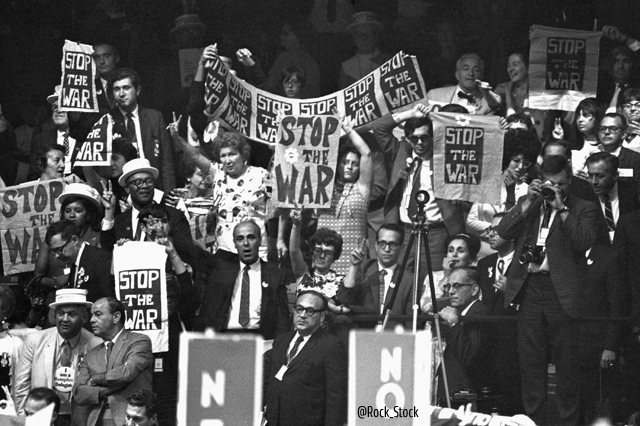 "1968, Chicago, Illinois, USA --- Delegates at the 1968 Democratic National Convention carry signs saying ""Stop The War"" in protest of the decision to adopt the Johnson-Humphrey Administration policy on the Vietnam War. --- Image by © Arthur Rothstein/CORBIS"
