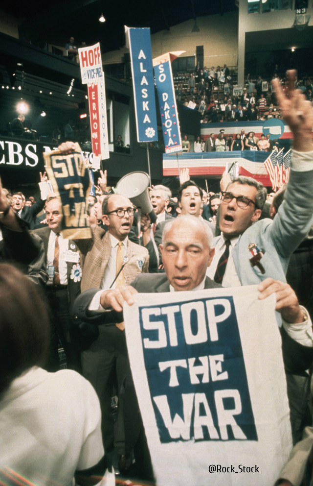 28 Aug 1968, Chicago, Illinois, USA --- Delegates at the 1968 Democratic National Convention carry signs in protest of the decision to adopt the Johnson-Humphrey Administration policy on the Vietnam War. --- Image by © Bettmann/CORBIS