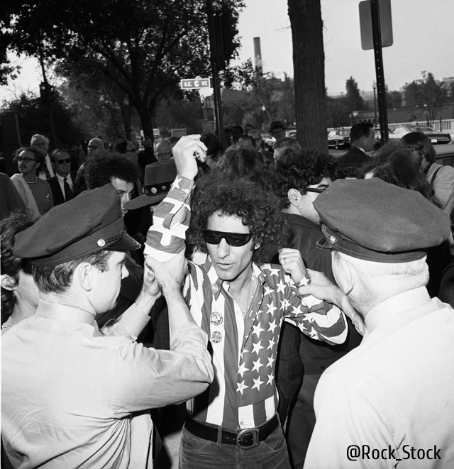 October 1968, Washington, DC, USA --- Abbie Hoffman is arrested while trying to interrupt a meeting of a subcommittee of the House Committee on Un-American Activities which is investigating the riots at the 1968 Democratic National Convention the previous August. --- Image by © Bettmann/CORBIS